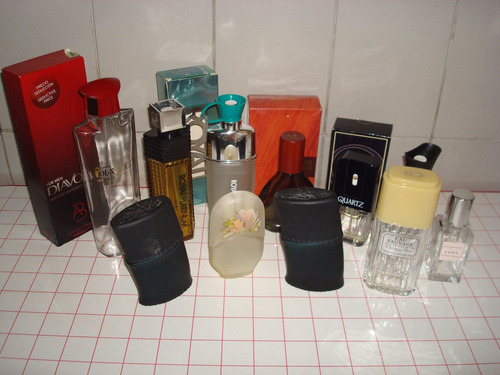 lote de 11 envases de perfumes importados vacios
