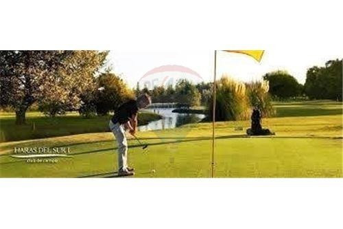 lote frente al campo de golf , en haras del sur ii