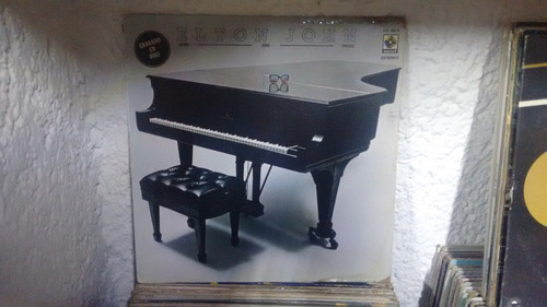 lp elton john here and there en acetato,long play