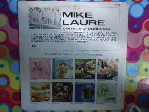 lp mike laure con sus creaciones tiburon, tiburon