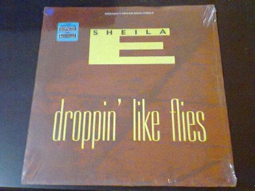 lp sheila e - droppin like flies. importado (eua), lacrado.