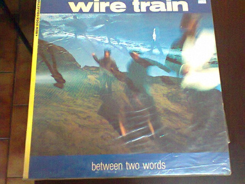 lp wire train. between two words. c/ encarte.