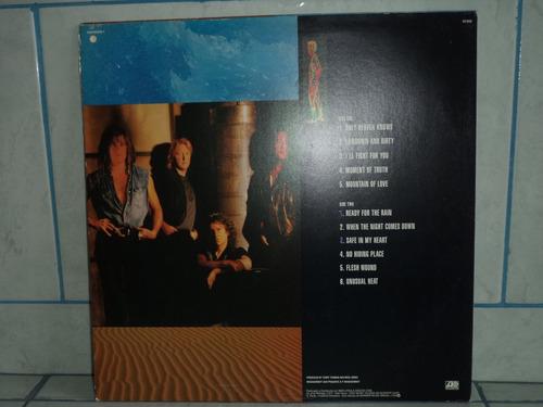 lp/disco popvar - foreigner - unusual heat 1981