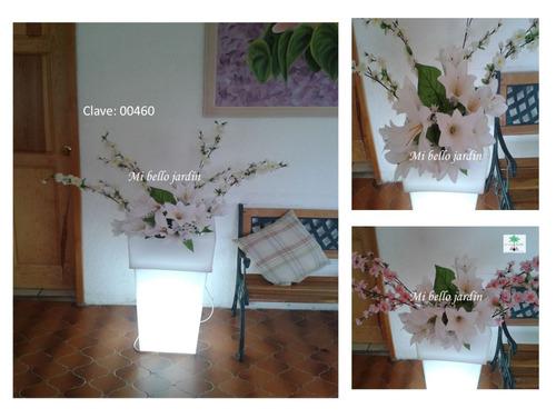 macetas iluminadas con plantas omm