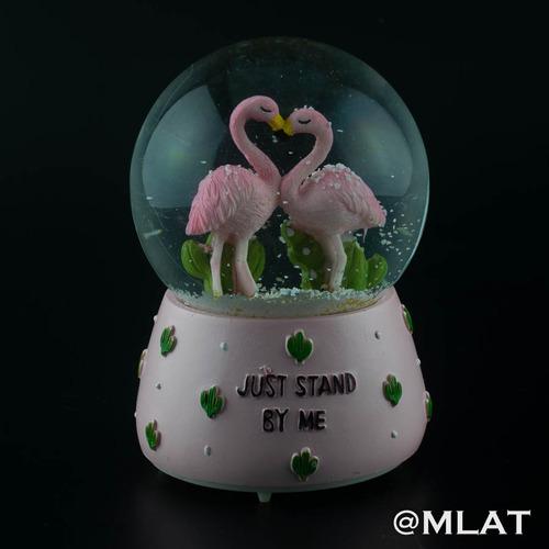 mágico globo bola de nieve musical pelícanos corazón amor.