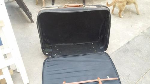 maleta travelin  con rueditas en buen estado $ 250