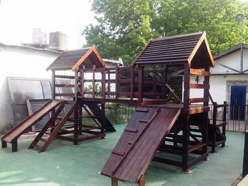 mangrullo de madera con puente y juegos para chicos