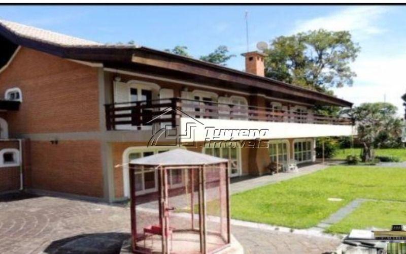 mansão em condomínio fechado