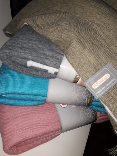 manta tejida cubre sillon pie de cama con flecos