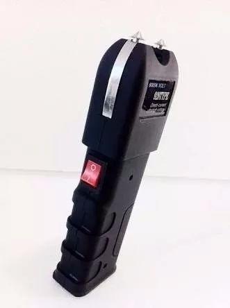 maquina aparelho de choque defesa pessoal taser 12.000kv