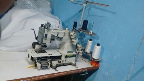 máquina de coser industrial resortera de 4 agujas.