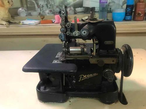 máquina de coser industrial urge