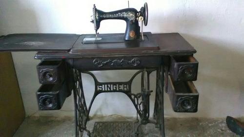 máquina de coser singer.