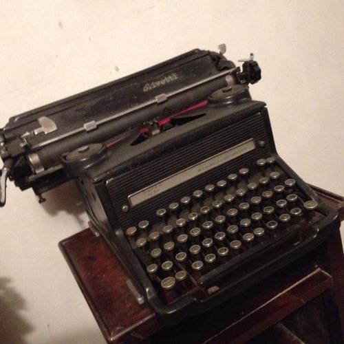maquina escrever olivetti bem antiga funciona perfeitamente!