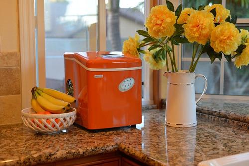 maquina portátil de hielo naranja