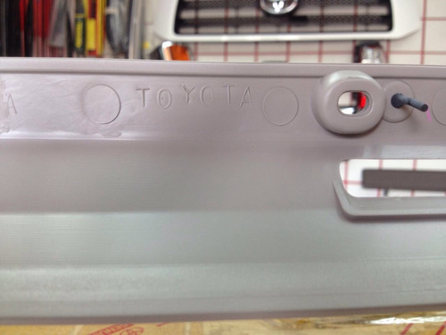 marco de guantera gris toyota corolla 1999-2002 original