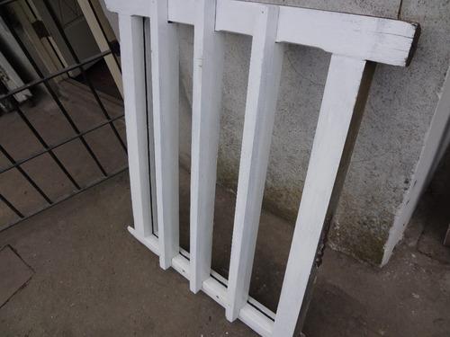 marco de madera dura con barrotes espigado