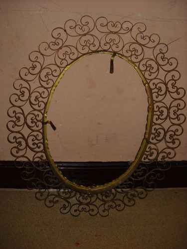 marco ovalado en hierro