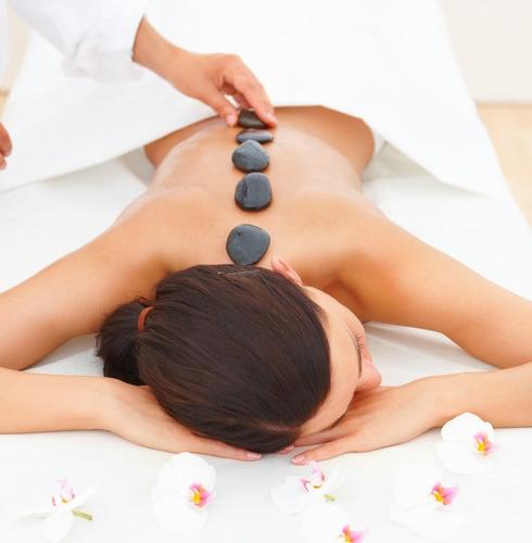 masaje descontracturante con piedras calientes parque rodo
