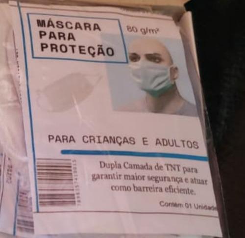 mascara descartavel de tnt embalada caixa com 50