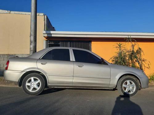 mazda 323 modelo 2003, 4 puertas