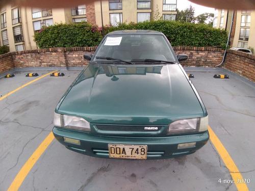 mazda 323,modelo 1998,inyeccion,ful equipo, venpermuto mayor