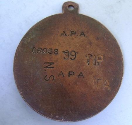 medalla colegio godspell
