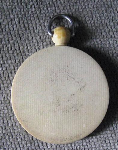 medalla religiosa antigua firmada diametro total 4.5 cms.