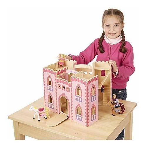 melissa y doug se pliegan y van al castillo de madera de la