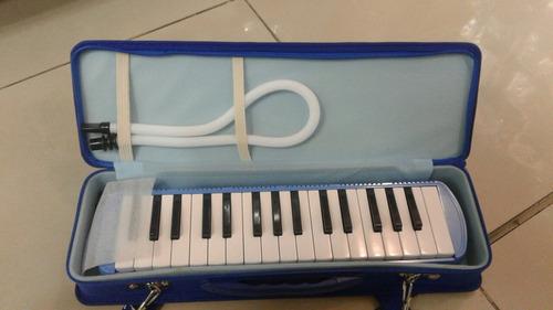 melodica aprendo con bolso