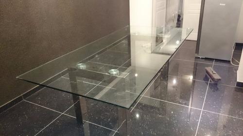 mesa comedor en vidrio con patas cromadas y pegado laser