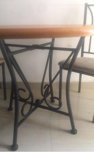 mesa redonda de hierro forjado