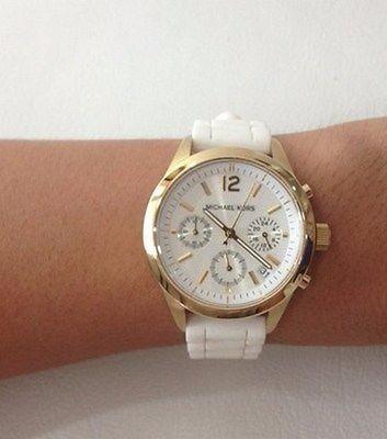 8582405aff7 Relógio Michael Kors Mk-5406 Dourado Com Silicone Branco - R  499