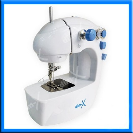 mini máquina de coser. incluye pedal agujas carreteles trafo