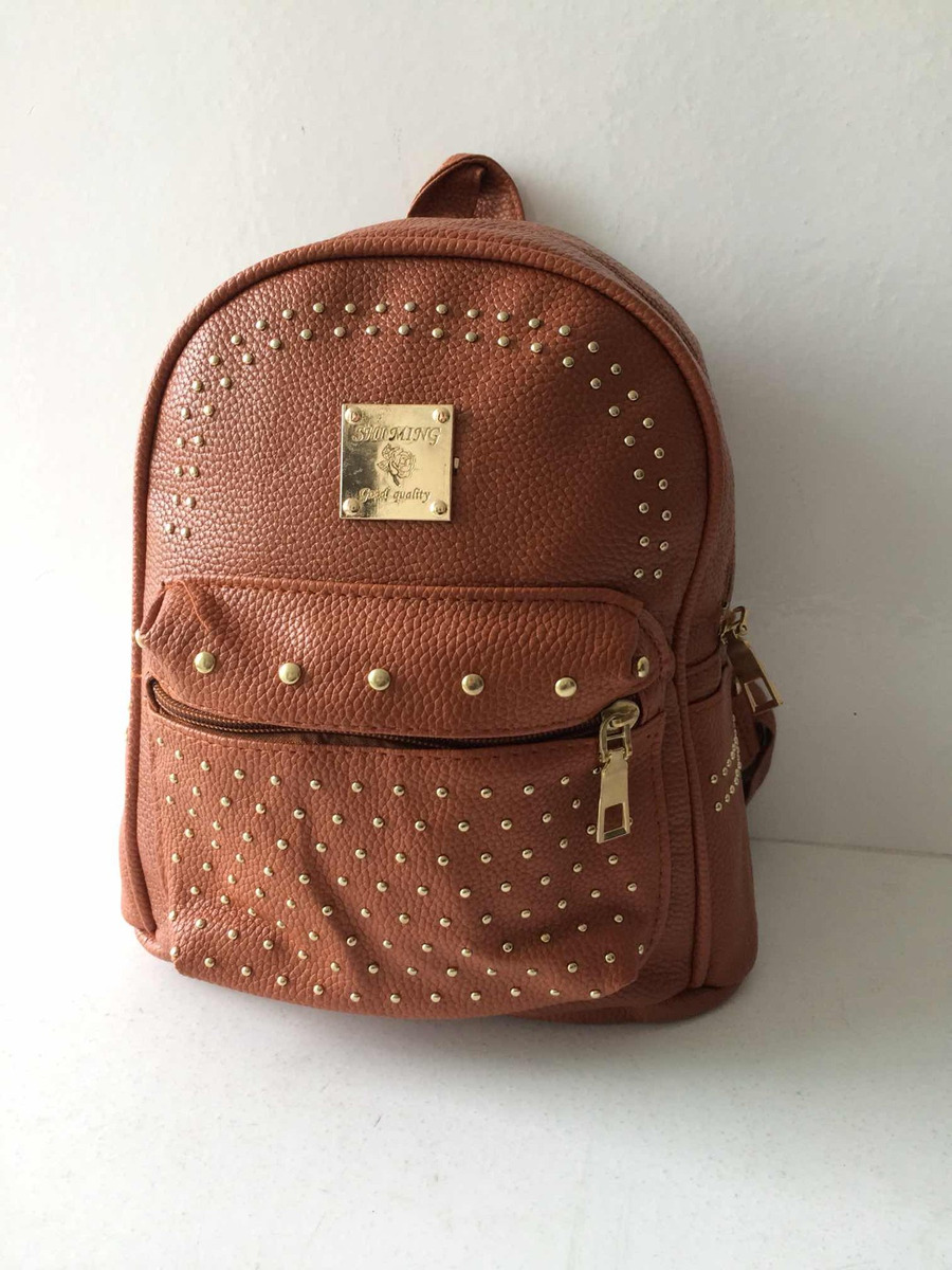 fe7df2c61 mini mochila marrom caramelo spikes dourado couro sintético. Carregando  zoom.