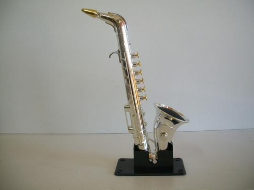 miniatura sax prateado brinquedo com 8 músicas 33 cms.