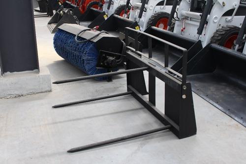 minicargadora taurus  - okm - 60 hp - garantida