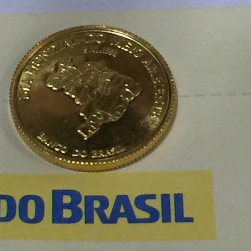 moeda em ouro 23k