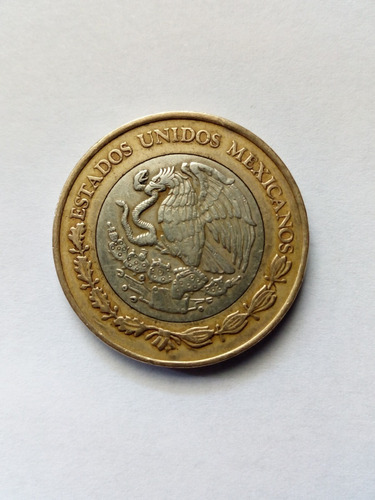 moneda 10 pesos grafila invertida