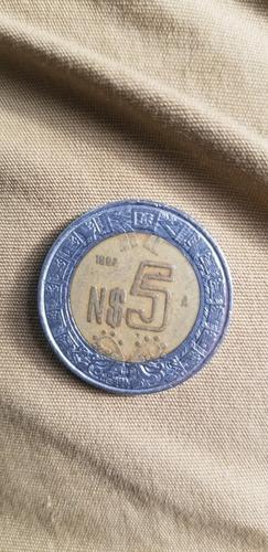 moneda de 5 pesos con n