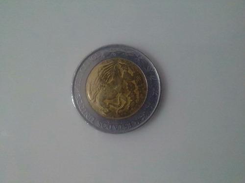 moneda de un peso con n$