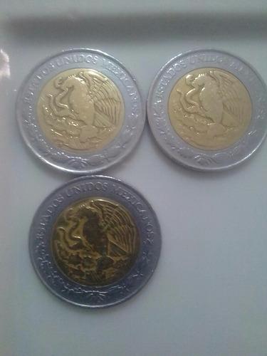 monedas de cinco pesos con n$