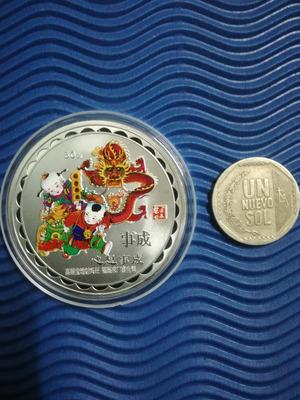 monedas plateadas zodiaco chino.