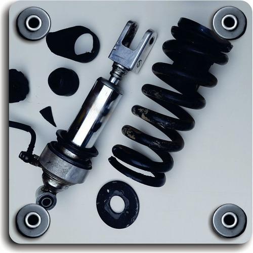 monoshock suspension motos cuatriciclos - reparación