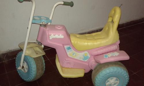 moto a batería,tres ruedas,rosada, buena calidad,usada,bien