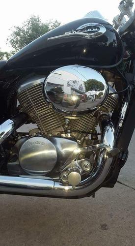 moto clásica impecable.