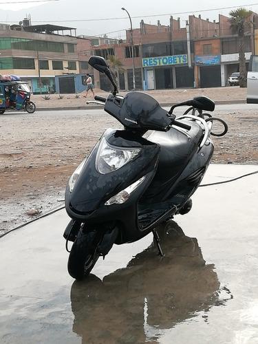 moto honda élite motor 125 en perfecto estado año 2012 con l