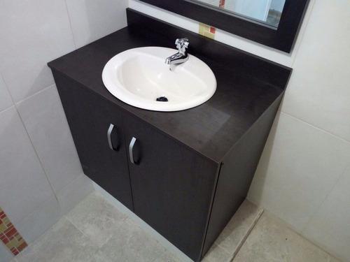mueble para baño con marco espejo