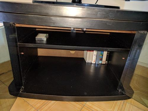 mueble tv giratoria negra con ruedas y estante