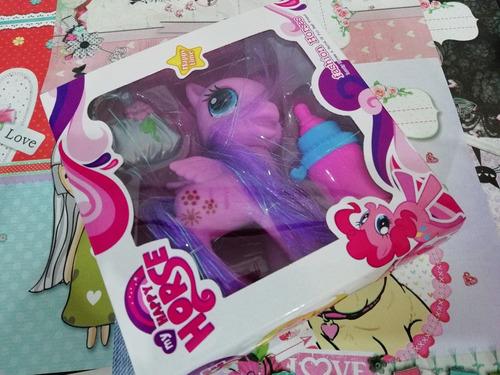 muñeco pony con mamadera y bolso nuevo en caja color violeta